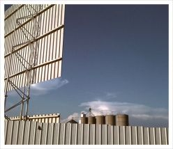 As you enter the property with grain silos in the background